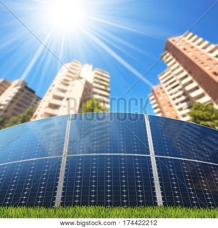 Group of solar panels in front of the apartment buildings with clear blue sky and sun rays