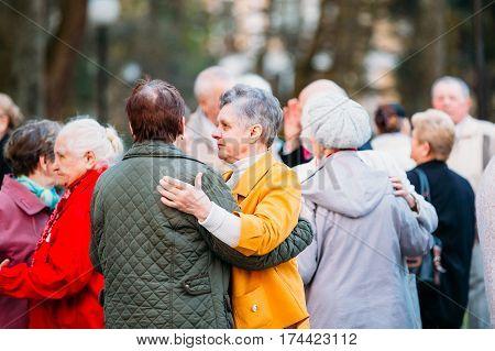 Gomel, Belarus - April 17, 2016:  Dancing Pair In Years On Outdoor Dance Floor Among Dancing Solus Elderly People In Summer Amusement Park In Gomel, Homiel, Belarus