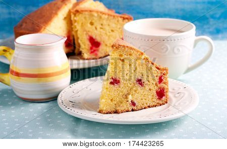Traditional English cherry cake sliced on plate