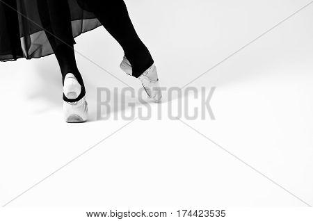 black and white photo of ballet dancer on white background