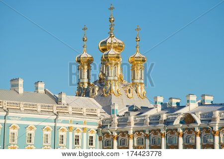 Domes of Voskresensky house church close up in the sunny February afternoon. A fragment of Catherine Palace in Tsarskoye Selo. St. Petersburg, Russia
