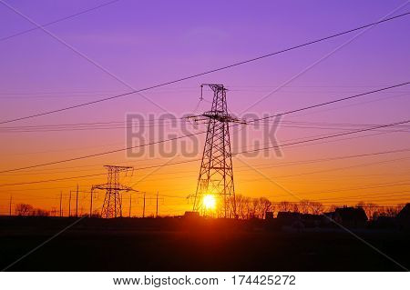 High voltage distribution power lines pylon at sunset (ukraine oblenergo)
