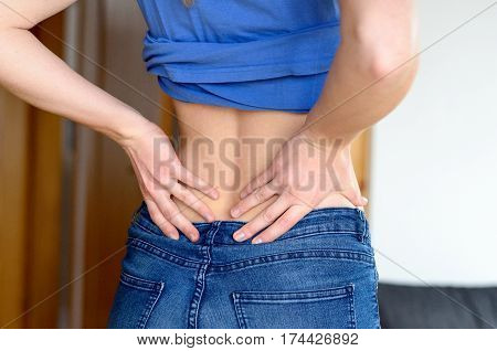 Rear View Of Young Woman Rubbing Her Back