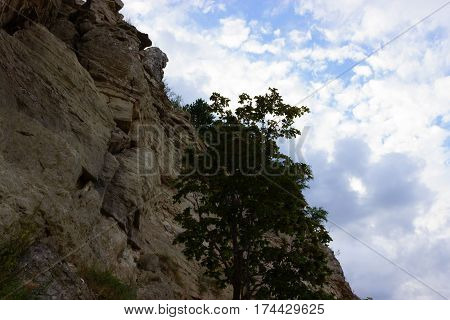Rock Wall Against A Blue Sky.