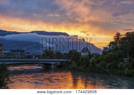 Grenoble architecture along Isere River seen at sunset. Grenoble Auvergne-Rhone-Alpes France.