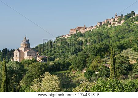Montepulciano, Italy - May 23, 2015: The cathedral or Duomo of Montepulciano on the hill under the village center of the hilltop town in Val d'Orcia valley Tuscany Italy.