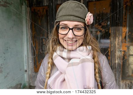 Portrait Of A Cheerful Girl In Glasses .