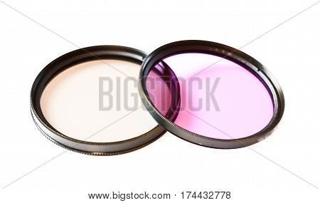 Polarizing and fluorescence lens filter isolated on white background photo abstract