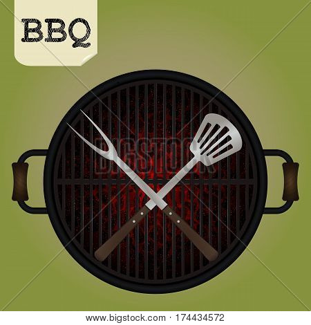 Big fork and spatula crossed on grill - top view