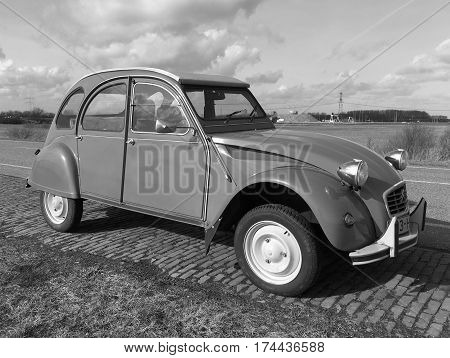 Almere, The Netherlands - February 21, 2017: Citroën 2CV (deux chevaux) parked by the side of the road in the city of Almere. Nobody in de vehicle.