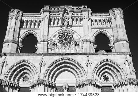 Cuenca (Castilla-La Mancha Spain) facade of the medieval cathedral in gothic style. Black and white