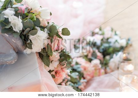 Flowers. Decoration of wedding table in ivory colors