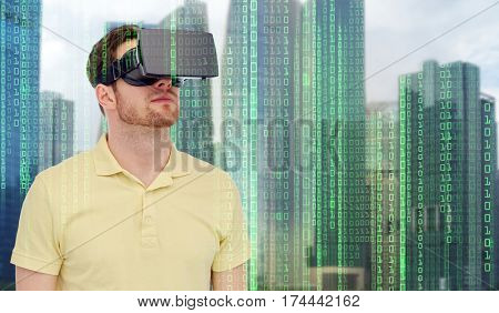 modern technology, cyberspace, entertainment and people concept - young man with virtual reality headset or 3d glasses over city skyscrapers and binary code background