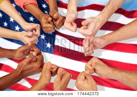 international, diversity, patriotism, ethnicity and people concept - hands showing thumbs up over american flag background
