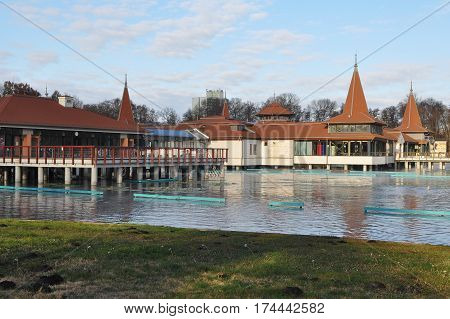 Lake Heviz with buildings of the famous Heviz Spa. Heviz, Hungary.