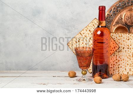 Passover holiday concept with wine and matzoh over rustic background
