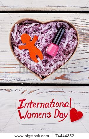Heart-shaped box and greeting. Sincere wishes on Women' day.