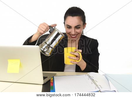 young attractive business woman at laptop computer desk pouring coffee on cup directly from coffee pot excited and anxious in caffeine addiction concept isolated on white background poster