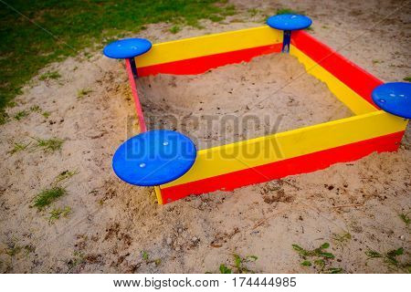 A Nice Sandbox Playground Filled . Surrounded By Green Grass,