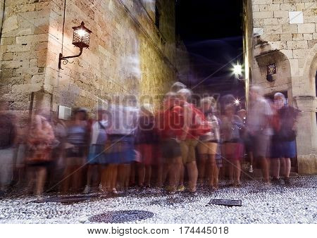 RHODES, GREECE - JUNE 23: Tourists walking along the stores of famous Socrates street at the old medieval town of Rhodes