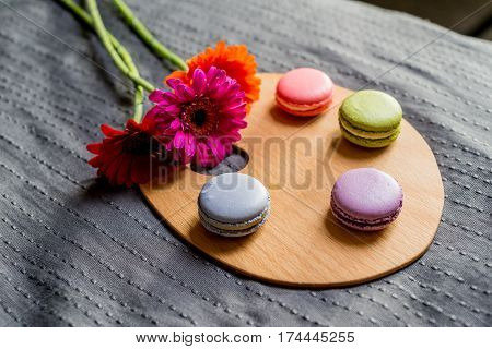 French Macarons And Colorful Flowers