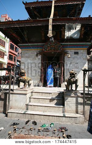 KATHMANDU, NEPAL. 23 September 2008: Urban residents in daily life. Pilgrims in ancient Hindu Temple in old Kathmandu, Nepal.