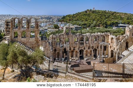 The Odeon of Herodes Atticus is a stone theatre structure located on the southwest of the Acropolis of Athens Greece
