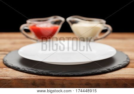Empty Plate And Condiments