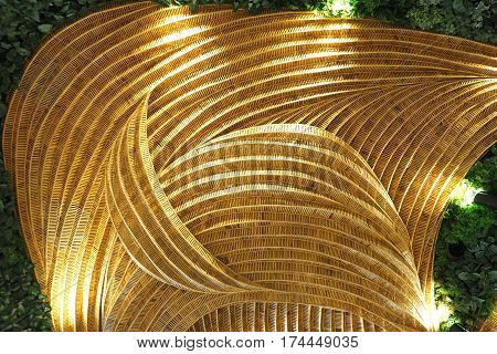 Rattan handicraft with leave concept flora background has spot light to decorate design.
