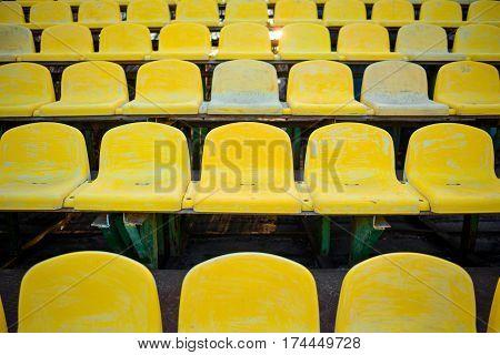 Old Yellow Seat In Stadium Closeup