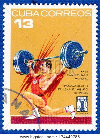 CUBA - CIRCA 1973: Postage stamp printed in Cuba  with a picture of a weightlifting, from the series
