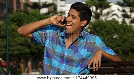 Happy Teen Boy Talking On Cell Phone