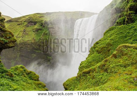 Scenic waterfall in pristine nature landscape of Iceland