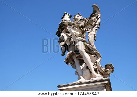 ROME, ITALY - SEPTEMBER 03: Statue of Angel with the Column by Antonio Raggi, Ponte Sant Angelo in Rome, Italy  on September 03, 2016.