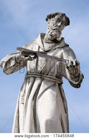 MARIBOR, SLOVENIA - APRIL 03: Saint Francis of Assissi statue, Plague column at Main Square of the city of Maribor in Slovenia, Europe. Historical religious sculpture, April 03, 2016.