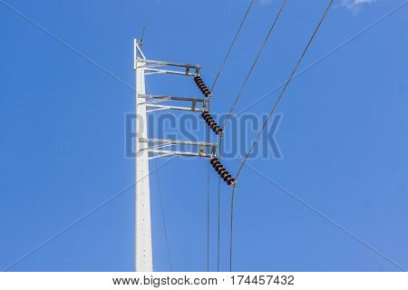 Electrical poles on white cloud and blue sky.