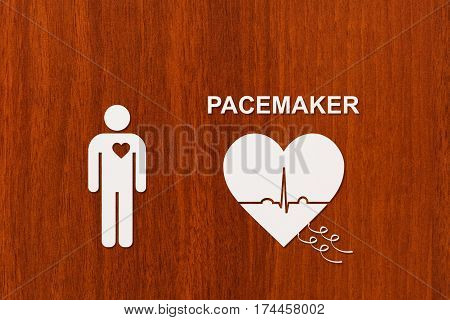 Man and heart shape with echocardiogram and PACEMAKER text. Medical cardiology concept