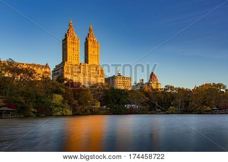 Sunrise on Upper West Side building and Central Park Lake. Manhattan New York City