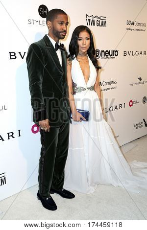 LOS ANGELES - FEB 26:  Big Sean, Jhene Aiko at the 25the Annual Elton John Academy Awards Viewing Party at the  City of West Hollywood Park on February 26, 2017 in West Hollywood, CA