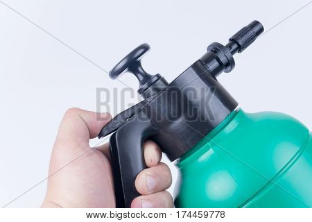 Plastic Water Pump In Hand Over White Background