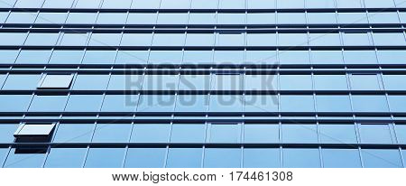 windows of office buildings. view of business center outside. rhythmic cityscape background