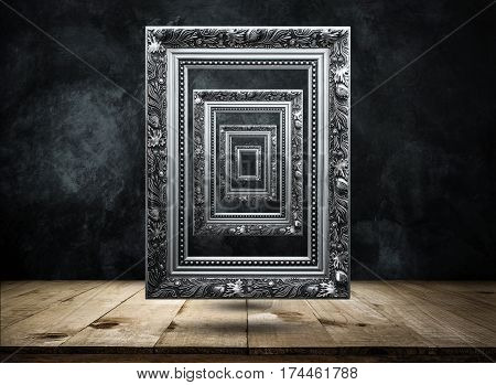 Silver Antique Picture Frame On Dark Grunge Wall With Wooden Table Top Mysterious, Confused, Backgro