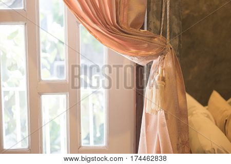 Beautiful curtain tie by curtain strap with sunlight