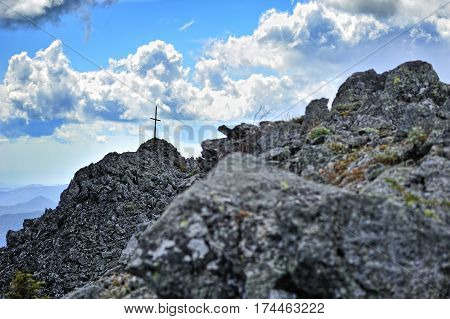 cross on the top rocky top of mountain beautiful landscape