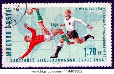 HUNGARY - CIRCA 1966: Postage stamp printed in Hungary with a picture of a football players, with the inscription