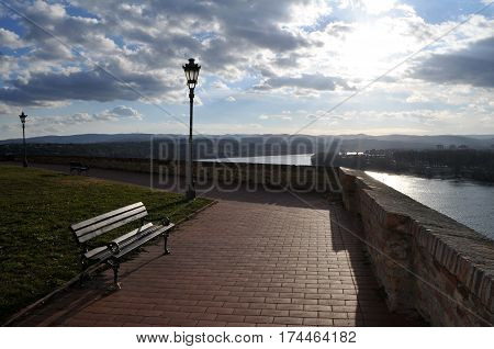 The bench next to the wall with unreachable views of the Danube and Novi Sad from the Petrovaradin Fortress, Serbia