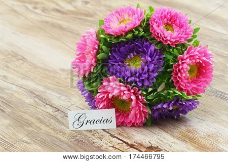 Gracias (which means thank you in Spanish) card with colorful daisy flower bouquet