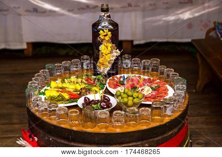 Cossack table. Ukrainian and Russian traditions. Snack for vodka and wrote on a wooden barrel