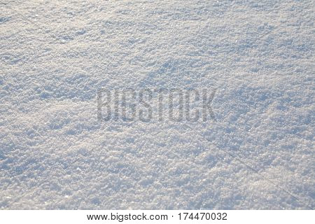 white shiny snow cover pattern closeup texture background