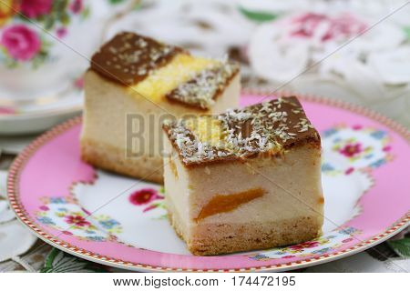 Pieces of baked cheesecake with peaches, closeup